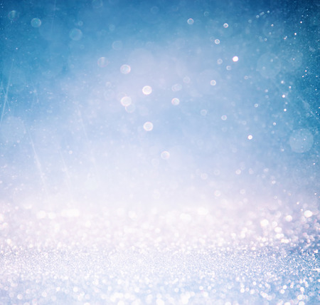 blurry: glitter vintage lights background with light burst . silver blue and white. defocused. Stock Photo