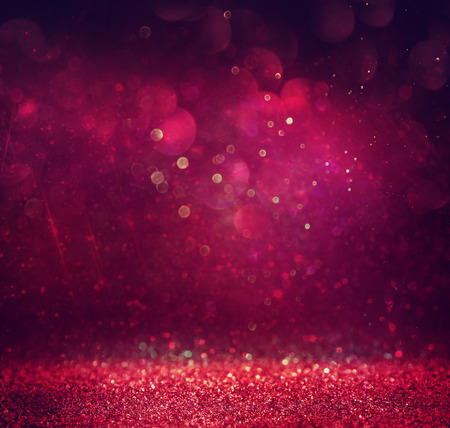 glittery: glitter vintage lights background. gold red and purple. defocused Stock Photo
