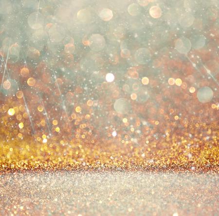 glitter vintage lights background. light gold and black. defocused. photo