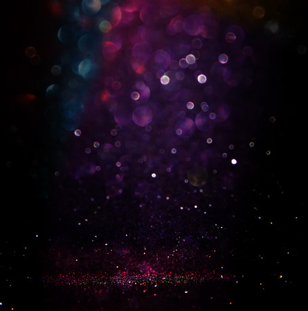glitter vintage lights background. light silver purple blue gold and black. defocused. Imagens
