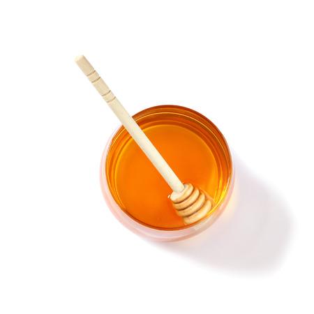 rosh hashanah jewesh holiday concept  honey isolated on white. traditional holiday symbols.