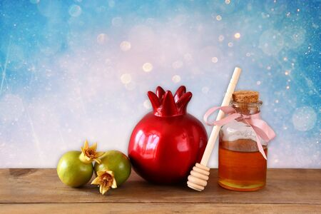apple honey: rosh hashanah jewesh holiday concept  honey and pomegranate over wooden table. traditional holiday symbols. Stock Photo
