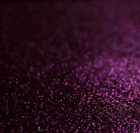 glitter vintage lights background. light silver  gold purple and black. defocused. photo