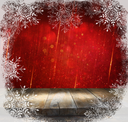 gild: rustic wood table in front of glitter red and gild bokeh lights with snowflakes overlay