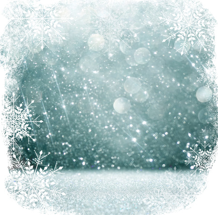 winter holiday: white and silver abstract bokeh lights. defocused background with snowflake overlay