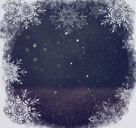 black and silver: glitter vintage lights background. light silver, blue and black. defocused. with snowflakes overlay