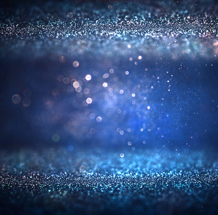 glimmer: glitter vintage lights background. light silver purple blue gold and black. defocused. Stock Photo