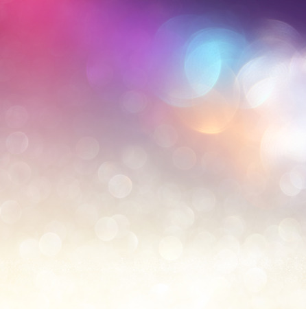 glitter vintage lights background. light silver purple blue gold and black. defocused. 스톡 콘텐츠