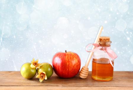 hashana: rosh hashanah jewesh holiday concept  honey apple and pomegranate over wooden table. traditional holiday symbols.