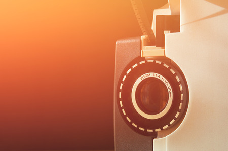 room for text: close up of old 8mm Film Projector lens. room for text. retro style image