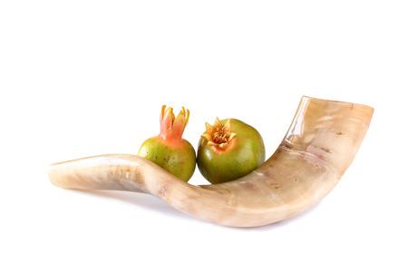 yom: shofar horn and pomegranate isolated on white. rosh hashanah jewish holiday concept . traditional holiday symbol.