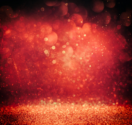 red glittery: glitter vintage lights background. gold, red and purple. defocused