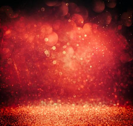 gold dust: glitter vintage lights background. gold, red and purple. defocused