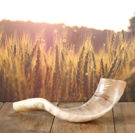 yom: shofar horn on wooden table. rosh hashanah jewish holiday concept . traditional holiday symbol. Stock Photo