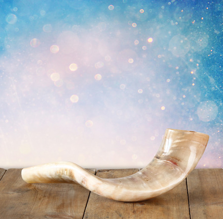 shofar horn on wooden table. rosh hashanah jewish holiday concept . traditional holiday symbol. Stock Photo