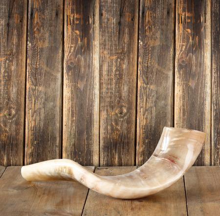 shofar: shofar horn on wooden table. rosh hashanah jewish holiday concept . traditional holiday symbol. Stock Photo