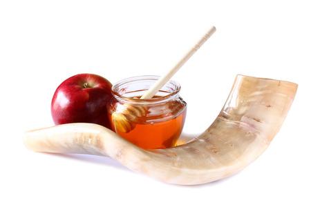 yom: shofar horn honey apple isolated on white. rosh hashanah jewish holiday concept . traditional holiday symbol. Stock Photo