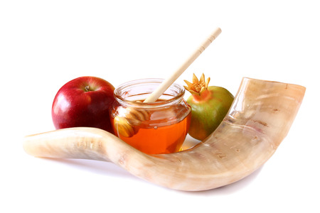 shana tova: shofar horn honey apple isolated on white. rosh hashanah jewish holiday concept . traditional holiday symbol. Stock Photo