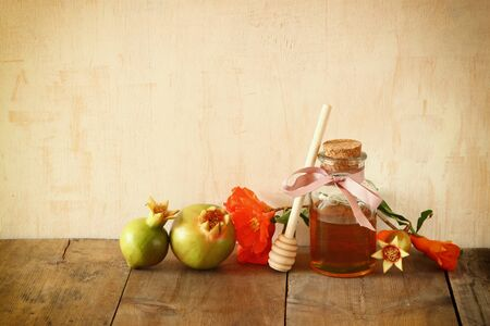 honey apple: rosh hashanah jewesh holiday concept - honey and pomegranate over wooden table. traditional holiday symbols. Stock Photo