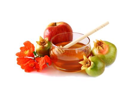 apple and honey: rosh hashanah jewesh holiday concept  honey apple and pomegranate isolated on white. traditional holiday symbols.