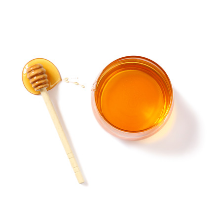 top of the year: rosh hashanah jewesh holiday concept  top view of honey isolated on white. traditional holiday symbols.