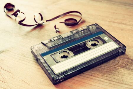 indie: close up photo of stack of Cassette tapes over wooden table . retro style image Stock Photo