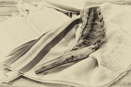 yom: shofar horn on white prayer talit. room for text. rosh hashanah jewish holiday concept . traditional holiday symbol.