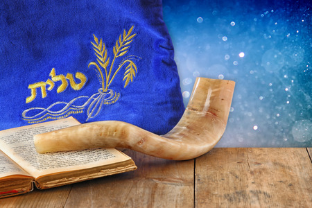 image of shofar horn and prayer case with word talit prayer writen on it. room for text. rosh hashanah jewish holiday concept . traditional holiday symbol.