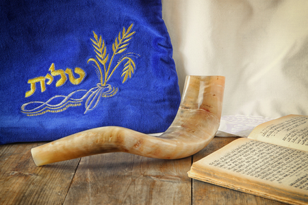 yom: image of shofar horn and prayer case with word talit prayer writen on it. room for text. rosh hashanah jewish holiday concept . traditional holiday symbol.