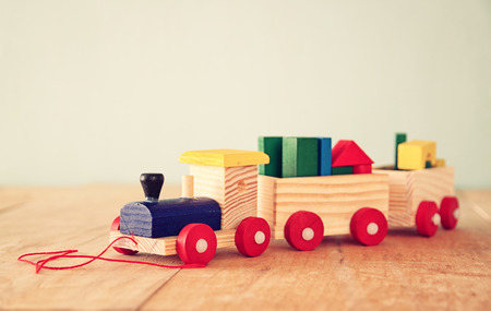 ut: close ut of Wooden toy train over wooden table. selective focus