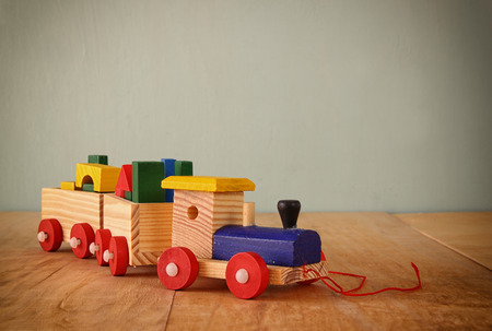 toy train: Wooden toy train over wooden table Stock Photo