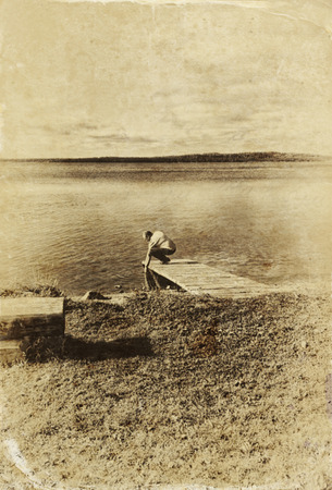 vintage photo: abstract old style photo of pier and lake landscape. black and white image