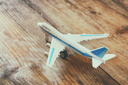 image style: toy airplane over wooden textured table. retro style image