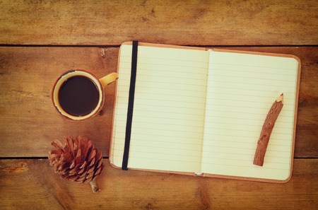 Merveilleux #45030481   Top Image Of Open Notebook With Blank Pages, Next To Pine Cones  And Cup Of Coffee Over Wooden Table