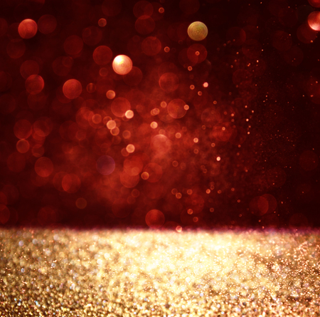 glittery: abstract background of red and gold glitter bokeh lights, defocused