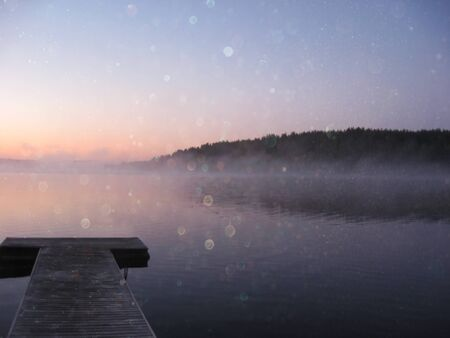 sunset lake: abstract photo of misty and foggy lake at sunset. Stock Photo