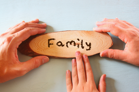 family hands holding sign with the word familly Stock Photo
