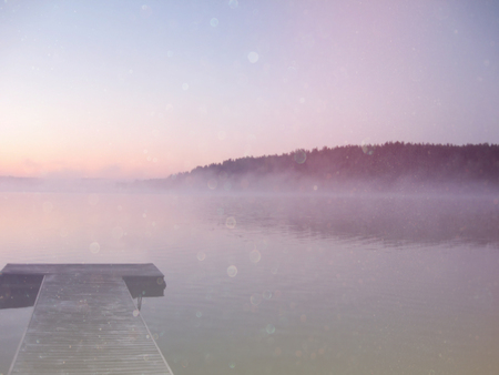 foggy: abstract photo of misty and foggy lake at morning sunrise.