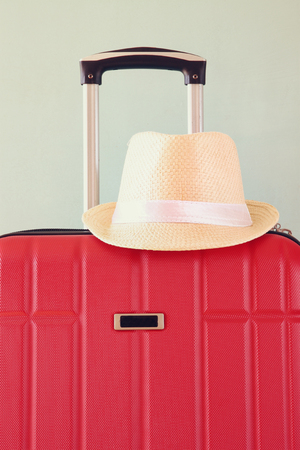 trolley case: red elegant travel luggage and fedora hat Stock Photo