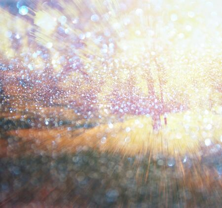 processing speed: abstract photo of light burst among trees and glitter bokeh lights. image is blurred and filtered