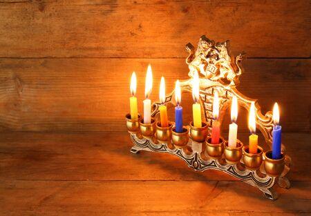 hanuka: Image of jewish holiday Hanukkah background with menorah traditional candelabra and Burning candles