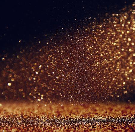 gold dust: glitter vintage lights background. gold and black. defocused Stock Photo