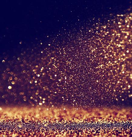 キラキラ ビンテージ ライト背景。金と黒。デフォーカス