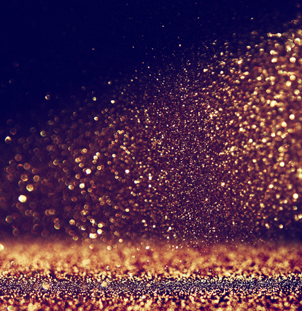 glowing: glitter vintage lights background. gold and black. defocused Stock Photo