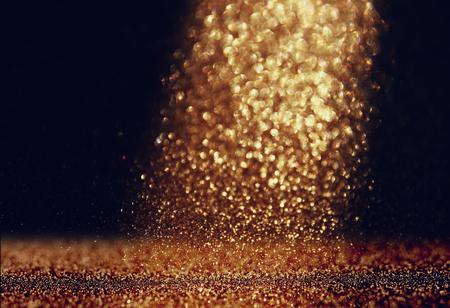 glitter vintage lights background. gold and black. defocused Foto de archivo