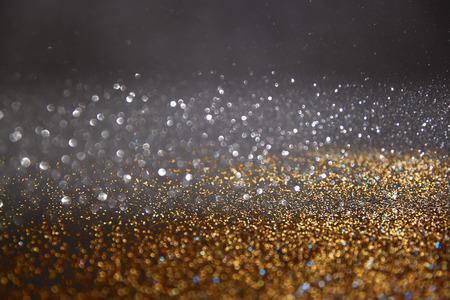 diamante negro: brillar luces de fondo de la vendimia. oro, azul y negro. desenfocado