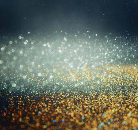 glitter vintage lights background. gold, blue and black. defocused