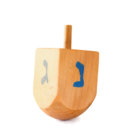 dreidel: wooden dreidel spinning top for hanukkah jewish holiday isolated on white