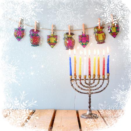 hanuka: image of jewish holiday Hanukkah with menorah traditional Candelabra with glitter overlay