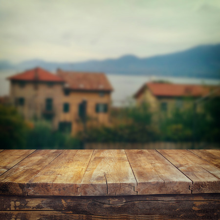 productos naturales: retro filtered image of old wooden table in front of romantic Provence rural landscape